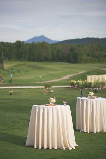 A couple of tables are set up for a tent wedding at Catamount Country Club