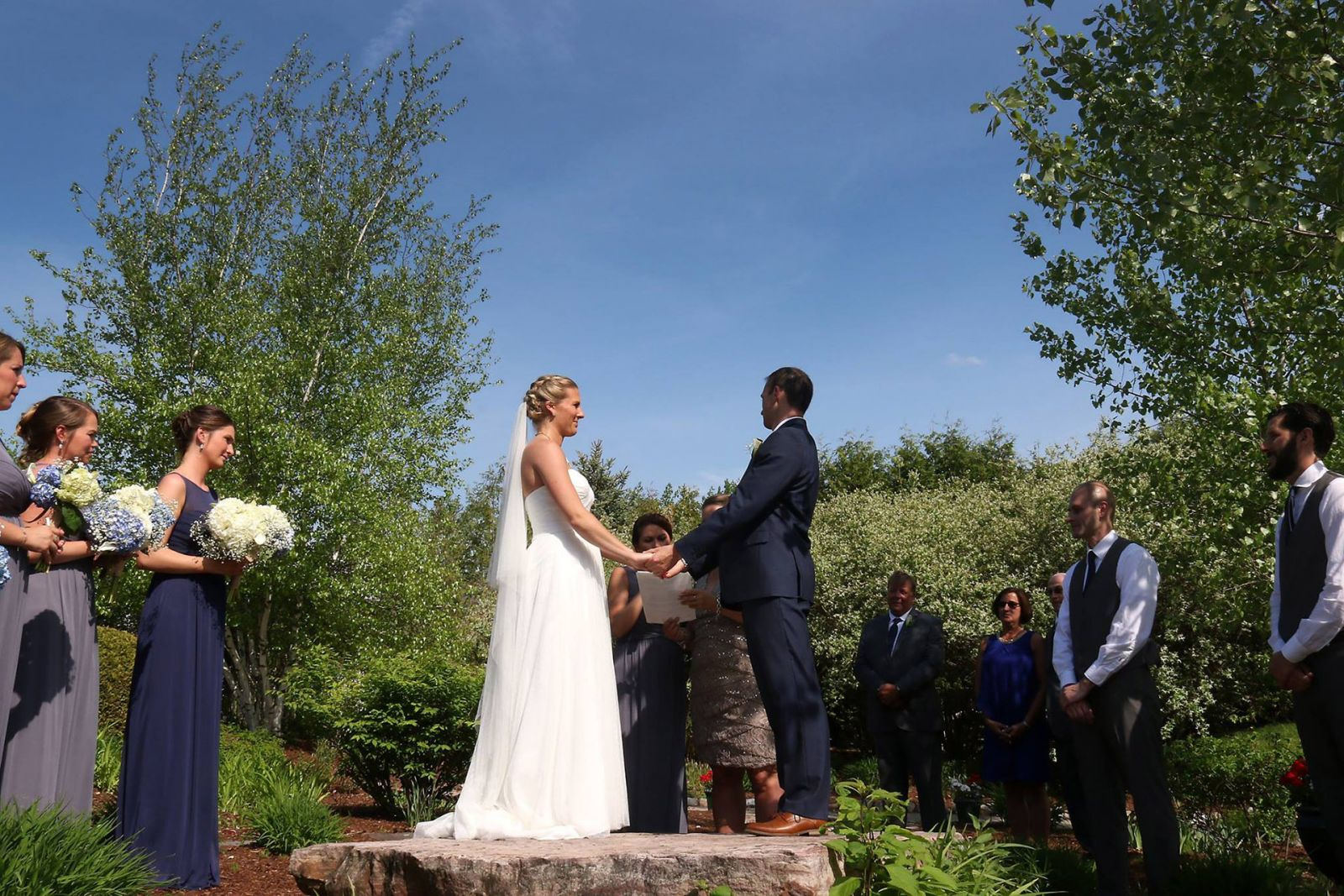 A couple embraces at the Garden Ceremony site at Catamount Country Club